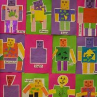 A wall display with figures created by the children in lots of different colours