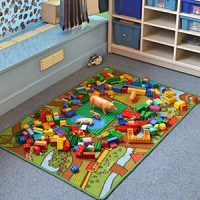 Mat with roads on it and lots of small, colourful play figures on it